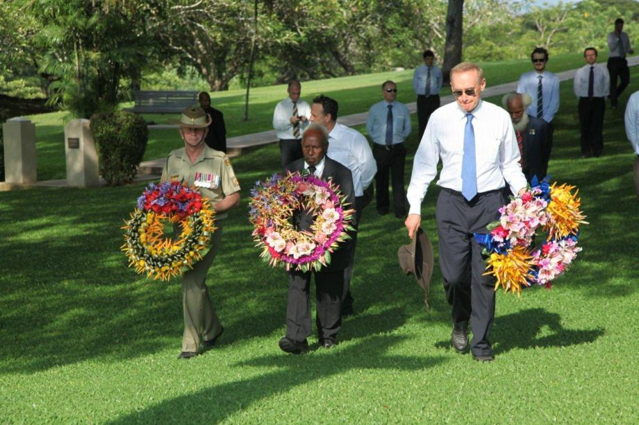 Foreign Minister Bob Carr, Fuzzy Wuzzy Angel Dickson Hango and Warrant Officer John Spargo lay wreaths at Bomana War Cemetery in Papua New Guinea on December 5, 2012 (Photo: Michael Wightman)