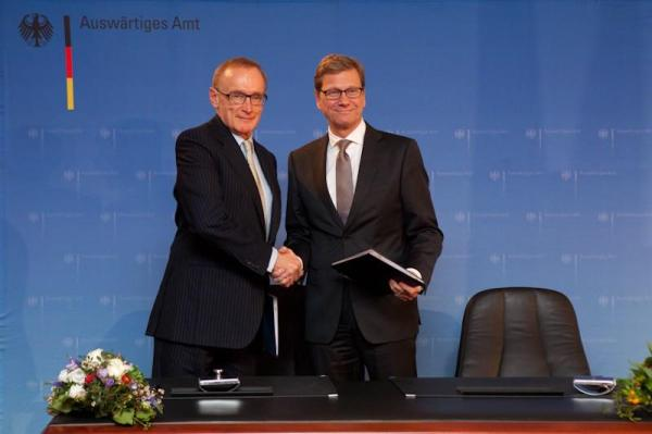 Foreign Minister Bob Carr and German Foreign Minister Guido Westerwelle sign off on Australia-Germany strategic partnership in Berlin on January 29, 2013